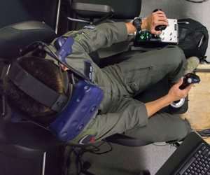U.S. Air Force Second Lt. Christopher Ahn, Pilot Training Next student, trains on a virtual reality flight simulator, at the Armed Forces Reserve Center in Austin, Texas, June 21, 2018.