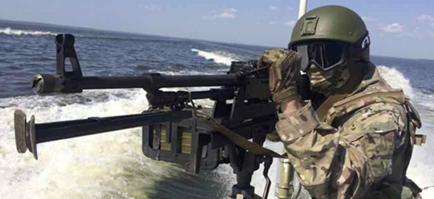 In this handout frame grab released on Thursday, Sept. 20, 2018 by Russian Defense Ministry Press Service, a Russian serviceman aims a machine-gun during the Russia's Baltic Fleet military exercises.