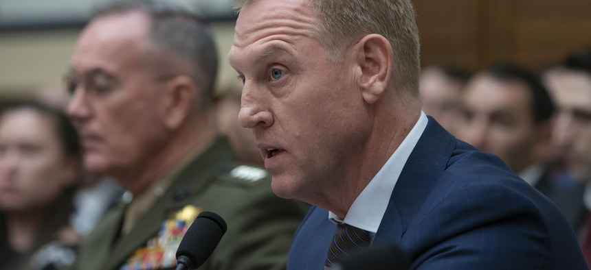 Acting Defense Secretary Patrick Shanahan, joined at left by Chairman of the Joint Chiefs of Staff Gen. Joseph F. Dunford, testifies at a House Armed Services Committee hearing on the fiscal year 2020 Pentagon budget, on Capitol Hill, March 26, 2019.