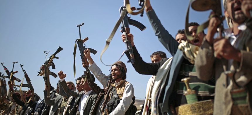 In this Dec. 13, 2018, file photo, tribesmen loyal to Houthi rebels hold up their weapons as they attend a gathering to show their support for the ongoing peace talks in Sanaa, Yemen.