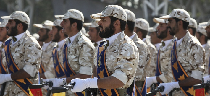 In this Sept. 22, 2011 photo, members of Iran's Revolutionary Guard march in front of the mausoleum of the late Iranian revolutionary founder Ayatollah Khomeini, just outside Tehran, Iran, during armed an forces parade.