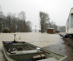 Backflow waters flood home property and farm land along Mississippi 16 near Rolling Fork, Miss., March 11.