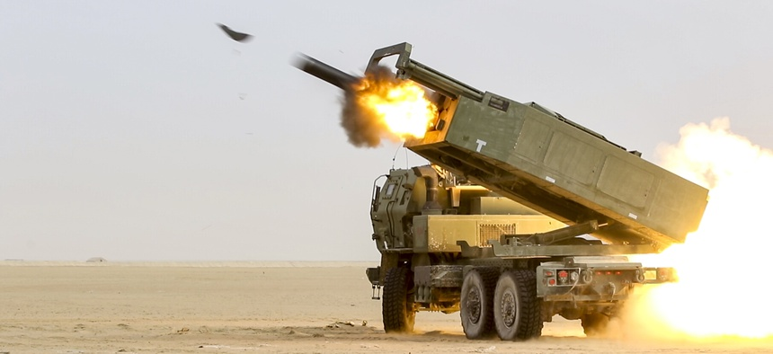 U.S. soldiers fire a High Mobility Artillery Rocket System during an exercise in Kuwait.