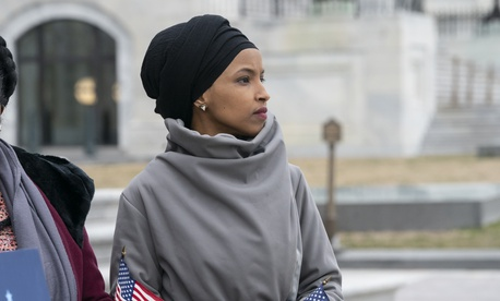 Rep. Ilhan Omar, D-Minn., stands outside the Capitol in Washington, Friday, March 8, 2019.