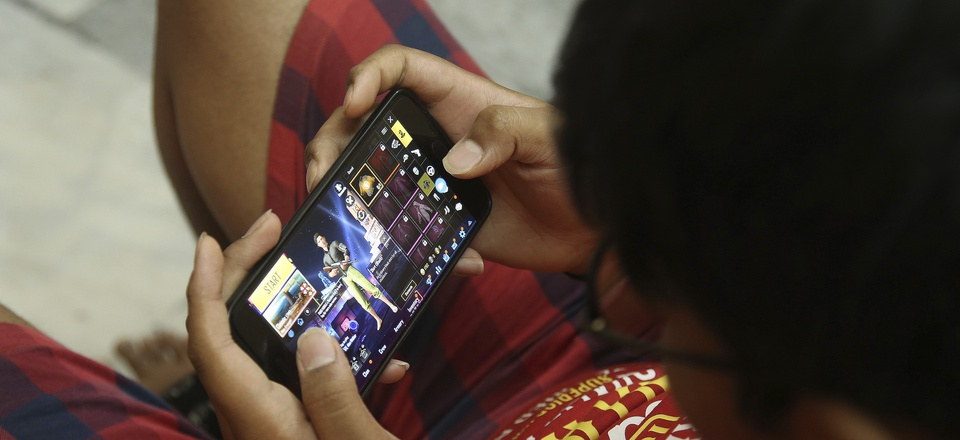 An Indian boy plays an online game PUBG on his mobile phone in Hyderabad, India, Friday, April 5, 2019.