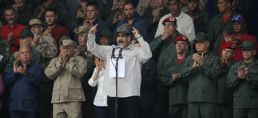 Venezuela's President Nicolas Maduro, speaks during the tenth anniversary celebration of the Bolivarian militia in Caracas, Venezuela, Saturday, April 13, 2019.