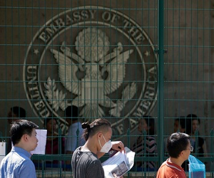 Visa applicants wait to enter the U.S. Embassy in Beijing in 2018.