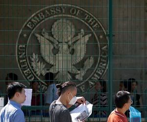Visa applicants wait to enter the U.S. Embassy in Beijing in 2018.