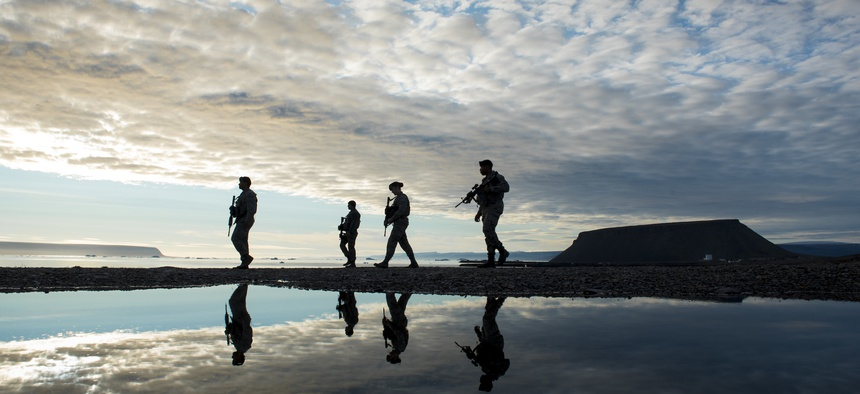 821st Security Forces Squadron members, walk back to their vehicle after responding to a training exercise at Thule Air Base, Greenland, Aug. 16, 2018.