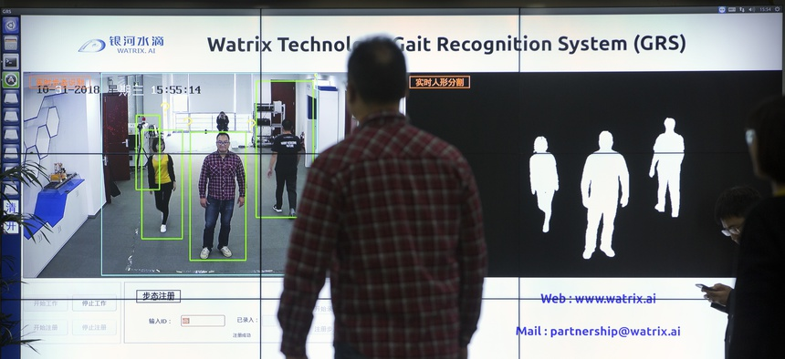 In this Oct. 31, 2018, photo, Watrix employees demonstrate their firm's gait recognition software at their company's offices in Beijing. A Chinese technology startup hopes to begin selling software that recognizes people by their body shape gait.