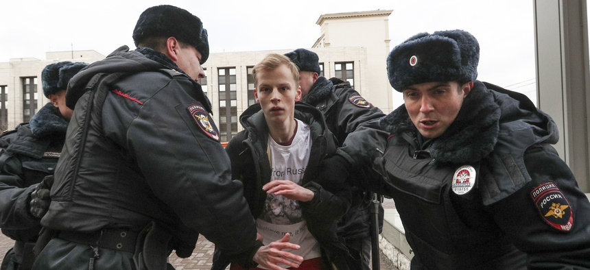 Police officers detain a demonstrator after the Free Internet rally in response to a bill making its way through parliament calling for all internet traffic to be routed through servers in Russia — making VPNs  ineffective in Moscow.