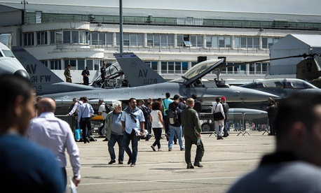 Crowds of industry professionals and media tour a pair of F-16 Fighting Falcons from Aviano Air Base, Italy, during the 51st International Paris Air Show at Le Bourget Airport, France, June 16, 2015.