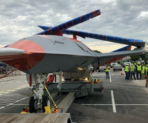 A prototype of the Navy's new MQ-25 carrier-based drone is driven to its test airfield in Illinois.