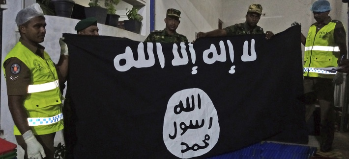 Sri Lankan police show an ISIS flag recovered from alleged hideout of militants, the week following Easter Sunday attacks claimed by the group, Friday, April 26, 2019