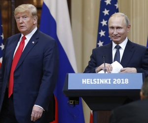 In this July 16, 2018, file photo, U.S. President Donald Trump, left, and Russian President Vladimir Putin arrive for a press conference after their meeting at the Presidential Palace in Helsinki, Finland.