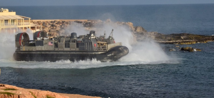 A U.S. amphibious hovercraft departs with evacuees from Janzur, west of Tripoli, Libya, Sunday, April 7, 2019.