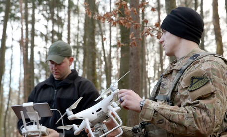 U.S. Army Sgt. Jesse Moore, left, and Pvt. Brandon Ruehl prepare to fly a reconnaissance quadcopter during training at Hohenfels Training Area, Hohenfels, Germany, in January 2018.
