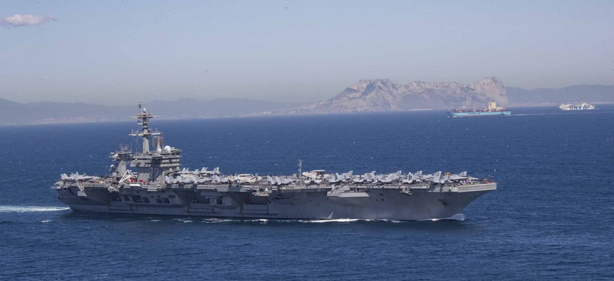 The Nimitz-class aircraft carrier USS Abraham Lincoln (CVN 72) transits the Strait of Gibraltar,