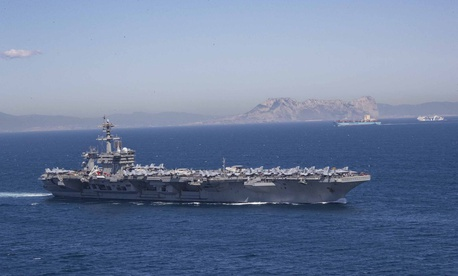 The Nimitz-class aircraft carrier USS Abraham Lincoln (CVN 72) transits the Strait of Gibraltar,