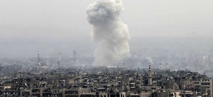 Smoke rises following a Syrian government air strike on rebel positions, in eastern Aleppo, Syria, Monday, Dec. 5, 2016.