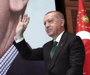 In an April 27, 2019, file photo, Turkey's President Recep Tayyip Erdogan gestures as he arrives to deliver a speech to members of his ruling Justice and Development Party (AKP) in Ankara, Turkey.