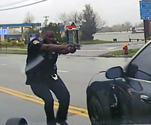 This still image from police dash camera video shows Police Officer Layau Eulizier on April 20 in Wethersfield, Conn., just before he fired through the window.