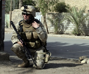 Second Lt. Joseph Davis of the 6th Marine Regiment, left, talks on the radio in Fallujah, Iraq, in 2005.