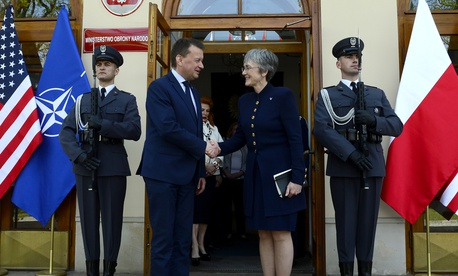 Air Force Secretary Heather Wilson greets Polish Defense Minister Mariusz Blaszczak in Warsaw.