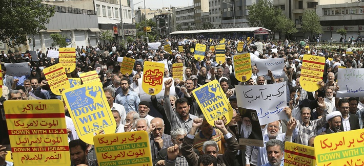 Worshippers chant slogans against the United States and Israel during a rally after Friday prayers in Tehran, Iran, Friday, May 10, 2019.