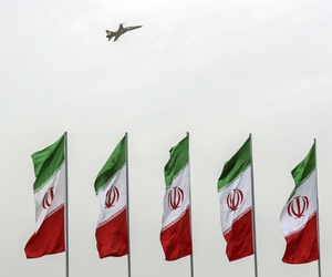 A fighter jet flies over Iranian flags during the army parade commemorating National Army Day in front of the shrine of the late revolutionary founder Ayatollah Khomeini, just outside Tehran, Iran, Thursday, April 18, 2019.