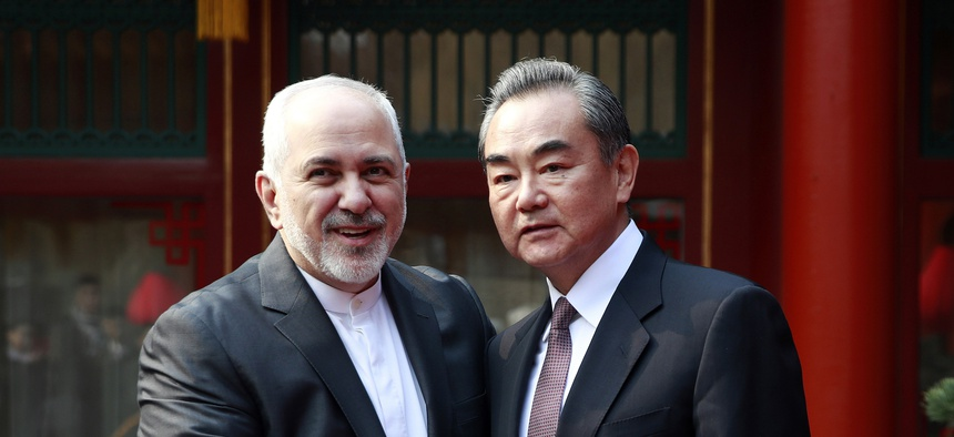 Iranian Foreign Minister Mohammad Javad Zarif, left, and his Chinese counterpart Wang Yi shake hands during their meeting at the Diaoyutai State Guesthouse in Beijing Tuesday, Feb. 19, 2019.