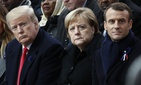 French President Emmanuel Macron, German Chancellor Angela Merkel and President Donald Trump attend a commemoration ceremony for Armistice Day at the Arc de Triomphe in Paris, France, Nov. 11, 2018.