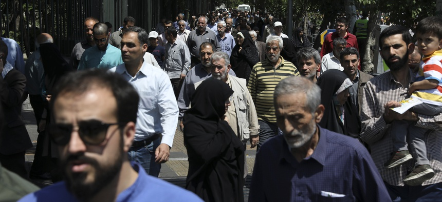 In this Friday, May 17, 2019 photo, worshippers leave at the conclusion of Friday prayers in downtown Tehran, Iran.