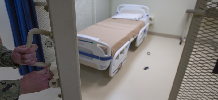In this photo reviewed by U.S. military officials, a hospital bed is shown inside the converted Camp V detention facility, Wednesday, April 17, 2019, in Guantanamo Bay Naval Base, Cuba.