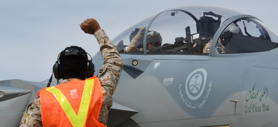 A Royal Saudi Air Force airman gestures to a F-15SA flight crew during Red Flag at Nellis Air Force Base in March 19