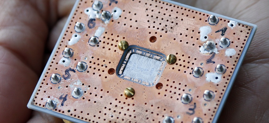 This Feb. 27, 2018, photo shows a seven cubit quantum device is seen at the IBM Thomas J. Watson Research Center in Yorktown Heights, N.Y.