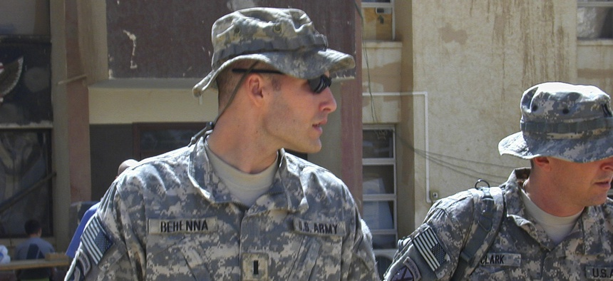 In this Sunday, Sept. 21, 2008, file photo, 1st Lt. Michael C. Behenna, left, and his defense attorney Capt. Tom Clark, right, walk in Camp Speicher, a large U.S. base near Tikrit, north of Baghdad, Iraq.