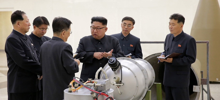 North Korean leader Kim Jong-un provides guidance with Ri Hong-sop (3rd L) and Hong Sung-mu (L) on a nuclear weapons program in this undated photo released by North Korea's Korean Central News Agency on September 3, 2017