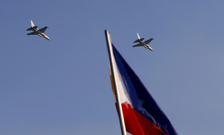 Two of the Philippines' KA-50 fighter jets fly over Manila in this 2015 photo.