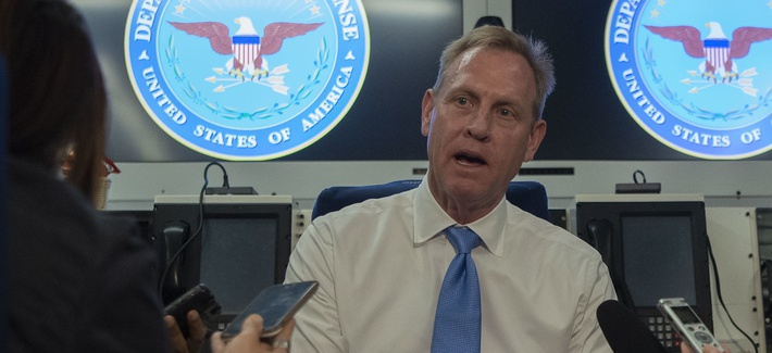 U.S. Acting Secretary of Defense Patrick M. Shanahan speaks with reporters aboard a government aircraft en route to South Korea, June 2, 2019.