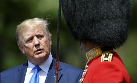 U.S. President Donald Trump inspects an honour guard during a welcome ceremony in the garden of Buckingham Palace, in London, for President Donald Trump and first lady Melania Trump Monday, June 3, 2019.