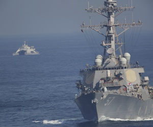 An Iranian Revolutionary Guard vessel, left, shadows the guided missile destroyer USS Mitscher on Dec. 21, 2018.