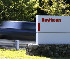 Workers drive into the Raytheon facility Monday, June 10, 2019, in Marlborough.