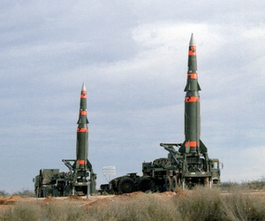 Several U.S. Pershing II intermediate-range ballistic missiles are prepared for launching at Fort Bliss's McGregor Range in New Mexico in December 1987.