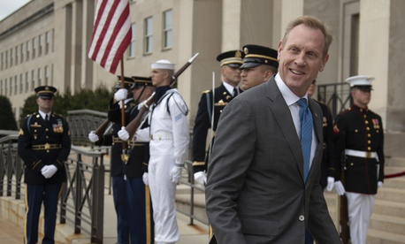 Acting Defense Secretary Patrick Shanahan awaits the arrival of Greek Defense Minister Evangelos Apostolakis at the Pentagon, Friday, June 7, 2019.