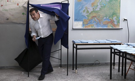 Greece's Prime Minister Alexis Tsipras casts his vote at a polling station in Athens on Sunday, May 26, 2019.