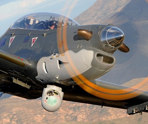 An MX-15D sensor ball by L3 Wescam, mounted on an Embraer Super Tucano.