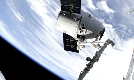 In this image taken from NASA Television, a SpaceX shipment arrives at the International Space Station following a weekend launch, Monday, May 6, 2019. The Dragon capsule reached the orbiting complex Monday, delivering 5,500 pounds (2,500 kilograms)