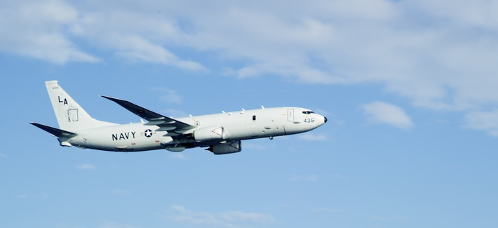 "A P-8A Poseidon, assigned to the ""Mad Foxes"" of Patrol Squadron (VP) Five from Okinawa, Japan, flies over the Philippine Sea."
