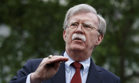 National security adviser John Bolton talks to reporters about Venezuela, outside the White House, Wednesday, May 1, 2019, in Washington.